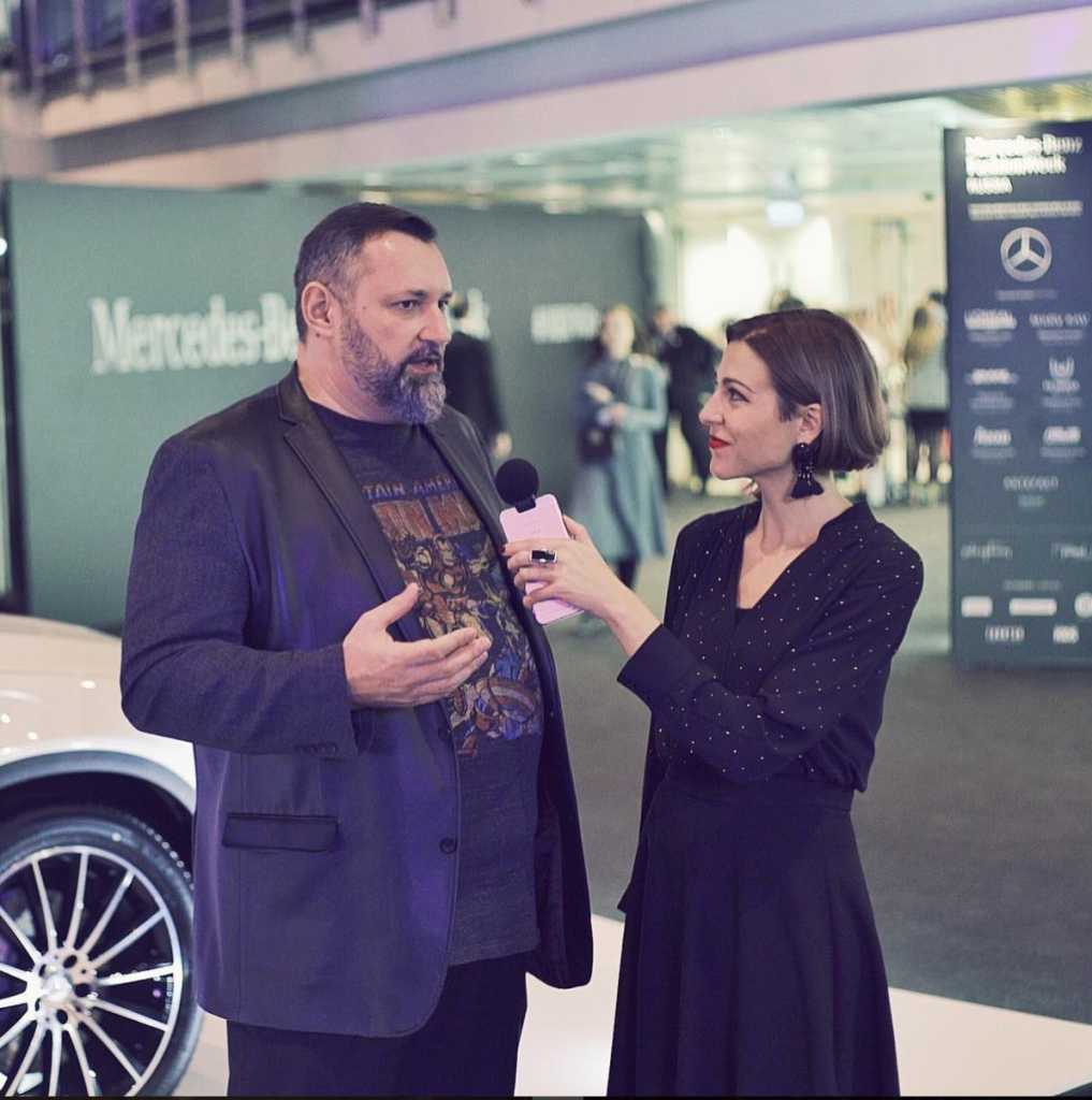 Fashion tech journalist Amanda Cosco, right, interviews Alexander Shumsky, left, the Executive President of the Russian Fashion Council and the President of Mercedes-Benz Fashion Week Russia.